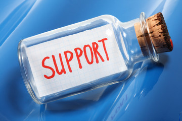 "Business concept of a message in a bottle ""support"""