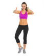 Full length portrait of happy fitness woman showing thumbs up