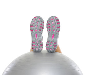 Closeup on leg laying on fitness ball