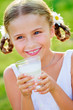 Health, diet - lovely girl drinking fresh milk outdoors