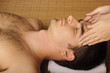 Man getting a face massage at spa