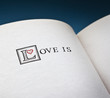 Love is words in the open book with blue background