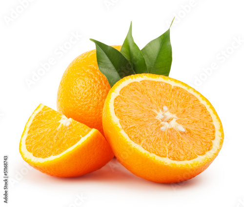 canvas print picture Ripe oranges with leaves