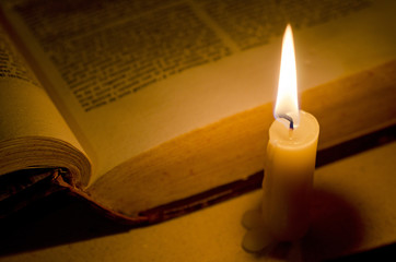 Candle and Open Book