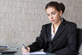 Businesswoman writing letter
