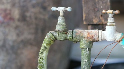 Water drop,leaking from old valve tap.