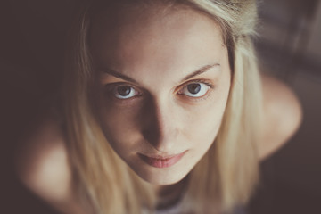 Portrait of the beautiful blond girl with sweet look