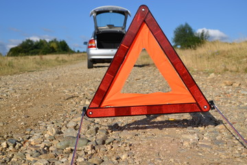 warning triangle behind a car