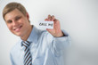 """Handsome businessman showing """"call me"""" text on a business card"""