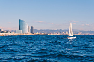 Sailing in Barcelona with the city in the background