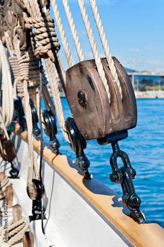 Ancient wooden sailboat pulley and ropes detail