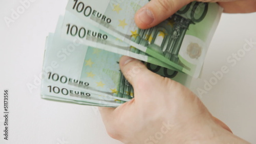 hands counting 100 euro money notes