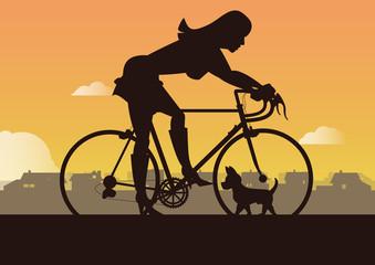 Frau mit Rennrad und Hund