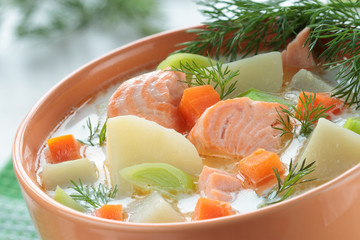 Salmon soup with cream,  carrots