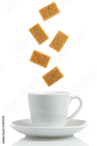 Brown sugar cubes with coffee cup