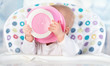 funny baby is eating from pink plate