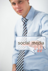 Business man touching social media button. Modern online adverti
