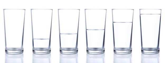 Six glasses with different levels of water