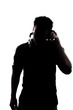 Male in silhouette listening to headphones