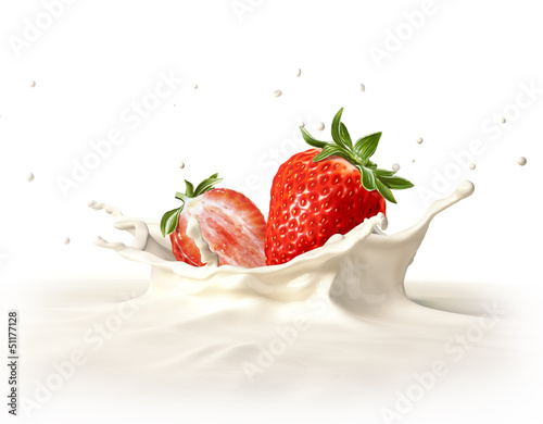 Two strawberries falling into milk splashing.