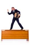 Arab businessman playing drum on desk