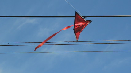 Kite stuck in wires. 2 shots.