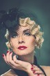 Elegant blond retro woman with red lipstick