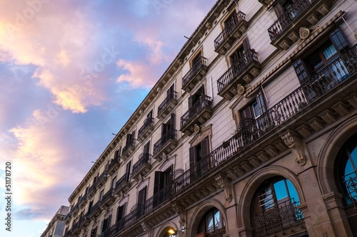 Building facade with  balconies against beautiful sky