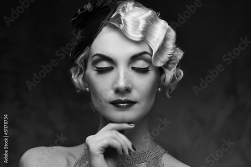 Monochrome portrait of elegant blond retro woman