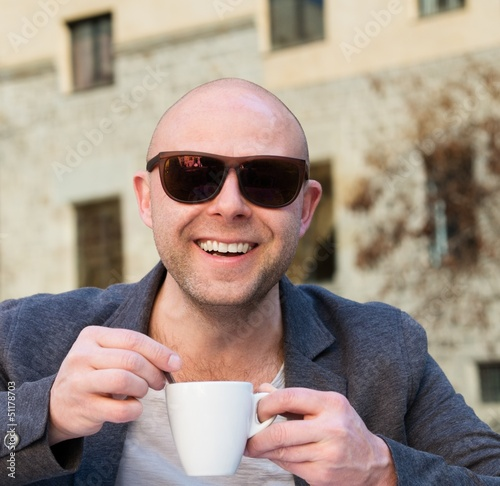 Cheerful middle-aged man with coffee cup