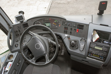 Modern bus dashboard and front seats view