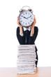 Woman businesswoman with giant alarm clock