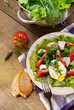 Fresh lidht salad with poached egg