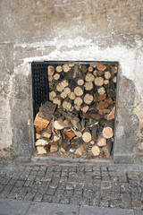 A small storage closet with firewood