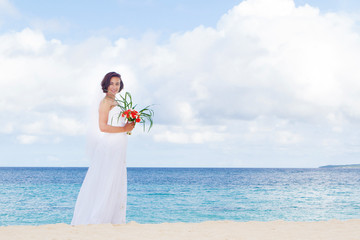 outdoor portrait of young beautiful woman bride in wedding dress
