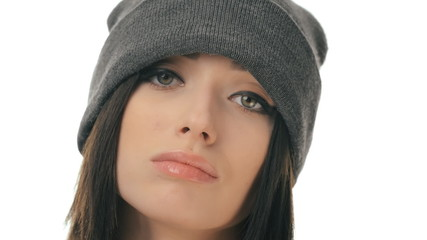 Insolent but beautiful teenager girl in a cap