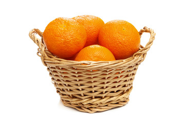 basket full of ripe sweet tangerine. Horizontal format over a wh