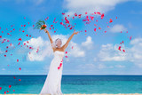 young hapy smiling bride on the wedding day on tropical beach an