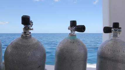 Scuba tanks on speeding dive boat. Shallow DOF.