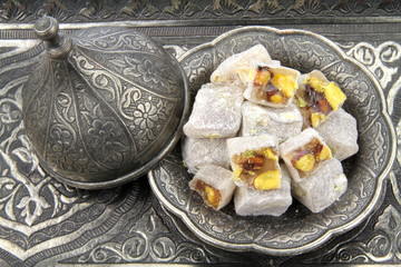 Turkish delight with traditional carved  patterned metal plate
