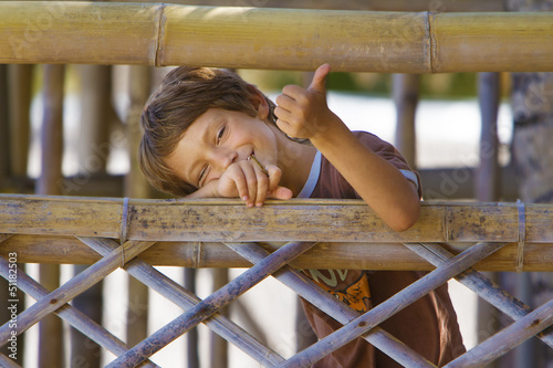 young happy smiling child boy enjoying summer outdoor portrait