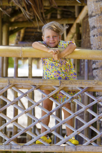young happy smiling child girl enjoying summer outdoor portrait
