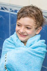 boy after bath in blue towel