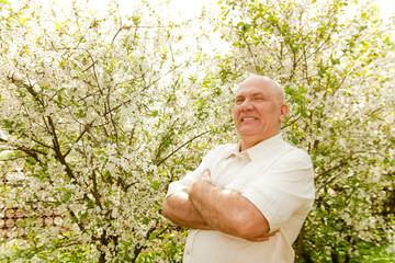 man in flowering garden