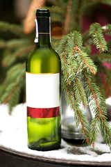 Composition of wine bottle on bright background