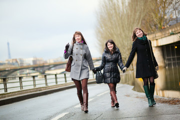 Friends having fun in Paris on a spring day
