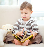 Little boy is reading book
