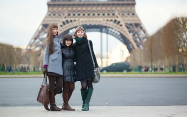 Three girls posing near the Eiffel tower
