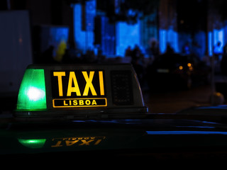 Lisboa taxi sign at night, Portugal