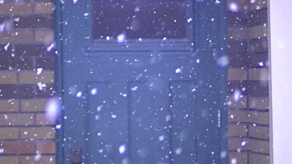 Falling snow in front of entrance door